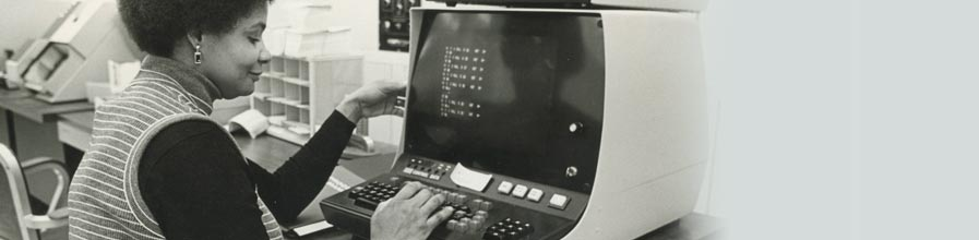 Student using a computer at the Columbia Point campus.